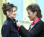 Post Script  Gov. Gen. Michaelle Jean (right) presents country music star Shania Twain, of Timmins, Ont., with the Order of Canada during an investiture ceremony at Rideau Hall in Ottawa F ...